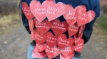 Runner Jillian Arany ran the Nova Scotia Remembers Memorial Race on Sunday, while wearing cut out paper hearts bearing the names of the 22 victims of the Nova Scotia mass killings that began on April 18, 2020.