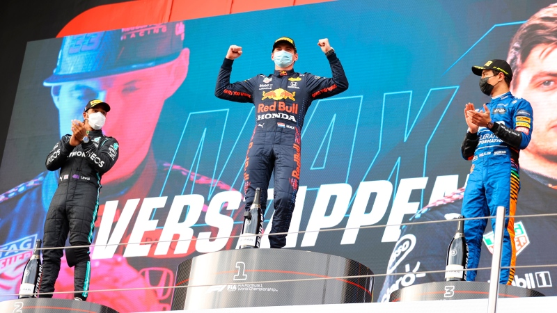 From left, second-placed Mercedes Lewis Hamilton, first-placed Red Bull's Max Verstappen and third-placed McLaren's Lando Norris celebrate on the podium at the end of the Emilia Romagna Formula One Grand Prix, at the Imola racetrack, Italy, Sunday, April 18, 2021. (Bryn Lennon/ Pool Via AP)