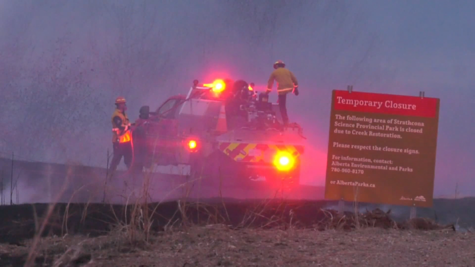 Strathcona County firefighters responded to a fire near the Strathcona Science Park that threatened railway tracks in the area Saturday evening (CTV News Edmonton/Sean McClune).
