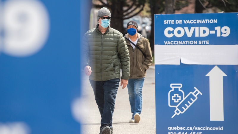 People are shown at a COVID-19 vaccination site in Montreal, Sunday, April 18, 2021, as the COVID-19 pandemic continues in Canada and around the world. THE CANADIAN PRESS/Graham Hughes