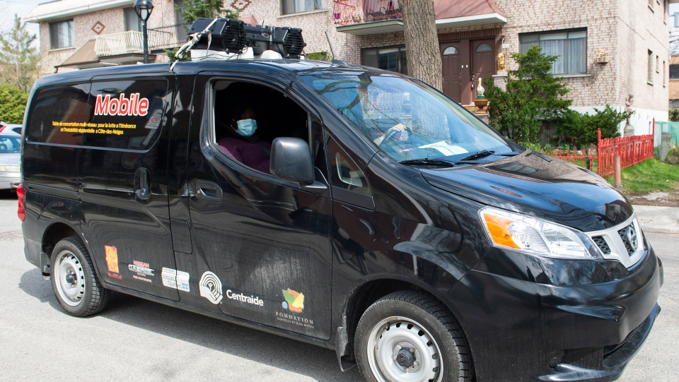 A van with loudspeakers is shown in Montreal