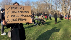 Protesters gather in Jeanne-Mance Park in opposition to Montreal's curfew on Sun., April 18, 2021. (Photo: CTV Montreal/Billy Shields)