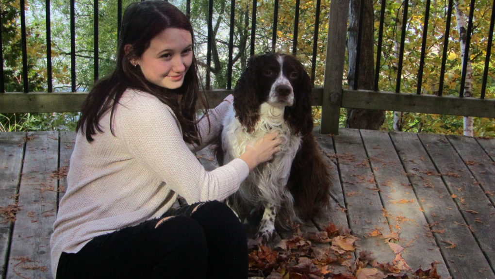 Hannah de Roux and her dog, Brady