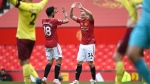 Manchester United's Bruno Fernandes, left, and Manchester United's Donny van der Beek celebrate third goal during the English Premier League soccer match between Manchester United and Burnley at the Old Trafford stadium in Manchester, England, Sunday, April 18, 2021. (Gareth Copley/Pool via AP)
