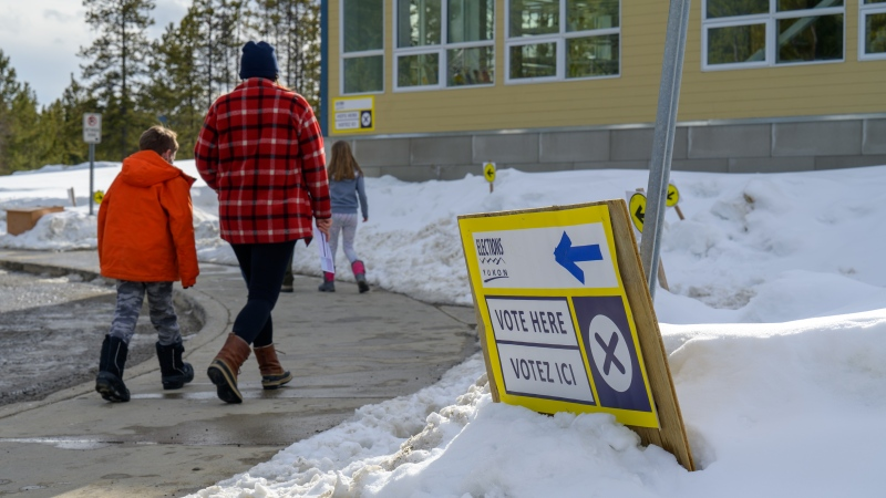 A voter and children arrive at a Whitehorse polling station during the Yukon election on Monday April 12, 2021. (THE CANADIAN PRESS/Mark Kelly)