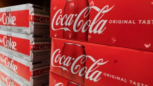 In this Monday, April 5, 2021 file photo, cases of Coca-Cola are displayed in a supermarket, in New York. (AP Photo/Mark Lennihan, File)