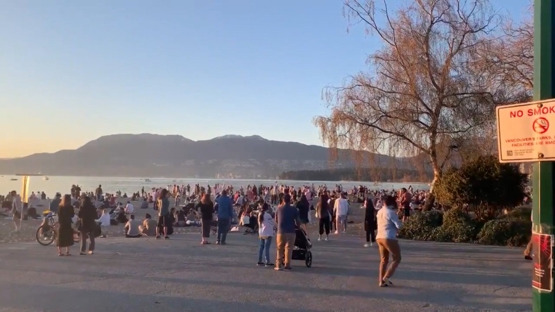 People gather at a Vancouver beach on a sunny April weekend in 2021.