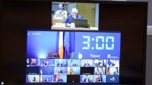 European Union foreign policy chief Josep Borrell, top of screen, speaks with EU foreign ministers via video link at the European Council building in Brussels, Monday, April 19, 2021. (Francois Walschaerts, Pool via AP)