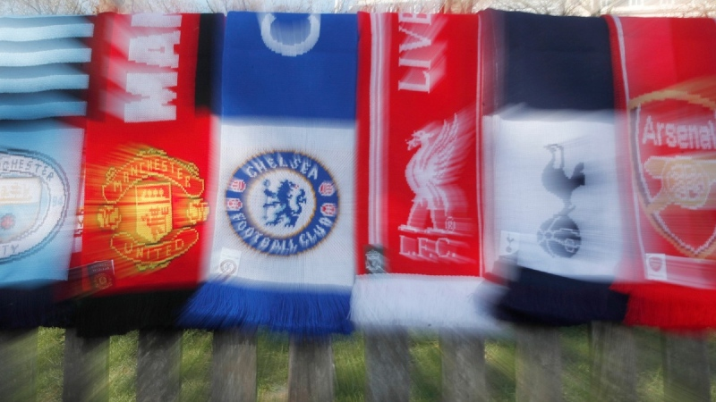 A selection of scarves of the English soccer Premier League teams who are reported to be part of a proposed European Super League, laid out and photographed in London, on April 19, 2021. (Alastair Grant / AP)