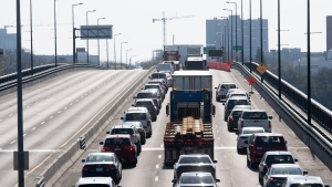 Vehicles entering Ontario from Quebec cross an interprovincial bridge on Monday April 19, 2021 in Ottawa. (Adrian Wyld/THE CANADIAN PRESS)