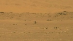 NASA's experimental Mars helicopter Ingenuity lands on the surface of Mars Monday, April 19, 2021. The little 4-pound helicopter rose from the dusty red surface into the thin Martian air Monday, achieving the first powered, controlled flight on another planet. (NASA via AP)