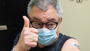 Dr. Horacio Arruda, Quebec's public health director, reacts after receiving a dose of the Moderna COVID-19 vaccine at a pharmacy, Monday, April 19, 2021 in St. Eustache, Que.THE CANADIAN PRESS/Ryan Remiorz