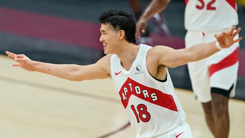 Toronto Raptors' Yuta Watanabe celebrates a three-point basket in the first half of an NBA basketball game against the Cleveland Cavaliers, Saturday, April 10, 2021, in Cleveland. The Toronto Raptors have signed Watanabe to a standard NBA contract. THE CANADIAN PRESS/AP Photo/Tony Dejak