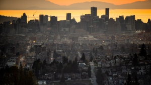 The downtown Vancouver skyline is seen at sunset, as houses line a hillside in Burnaby, B.C., on Saturday, April 17, 2021. (Darryl Dyck / THE CANADIAN PRESS)