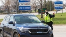 Ontario Provincial Police check travellers entering Ontario from Quebec as new COVID-19 measures take effect Monday, April 19, 2021 in Hawkesbury, Ontario. THE CANADIAN PRESS/Ryan Remiorz