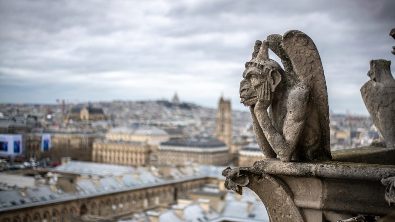 "A conservation group is offering members of the public the chance to donate to restore specific artifacts at the Notre-Dame cathedral in Paris, which was partially destroyed by fire in 2019. The stone ""grotesques"" sit in the upper gallery spanning the cathedral's two towers. (Edwin Remsberg/VWPics/AP via CNN)"