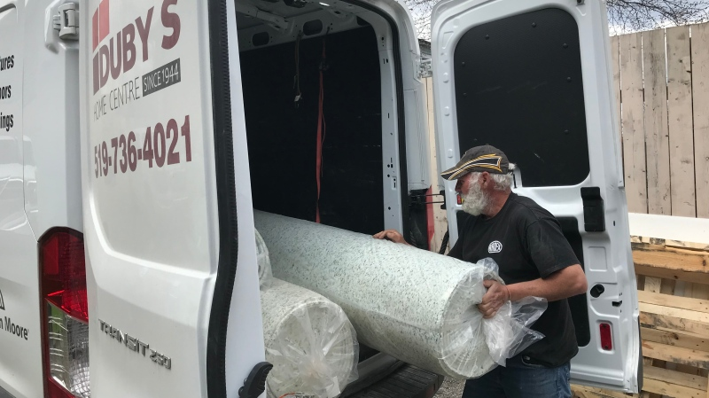 Tim Reaume loads carpet underlay into the work for Duby's Home Centre in Amherstburg, Ont. as home renovation companies are allowed to keep working inspire of Ontario's current lockdown on Monday, April 19, 2021. (Michelle Maluske/CTV Windsor)