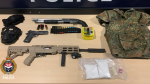 Some of the items seized by police, including three guns and body armour, are shown: (Victoria Police)