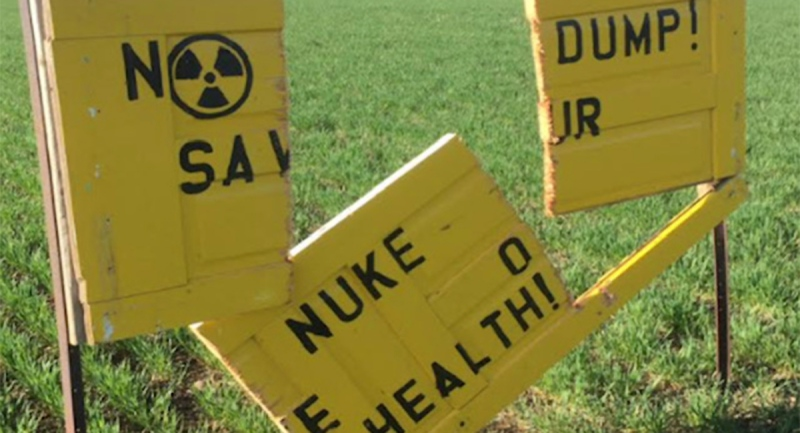 A damaged sign opposing the burial of high-level nuclear waste is seen in the Teeswater, Ont. are i April 2021. (Source: Protect our Waterways-No Nuclear Waste)