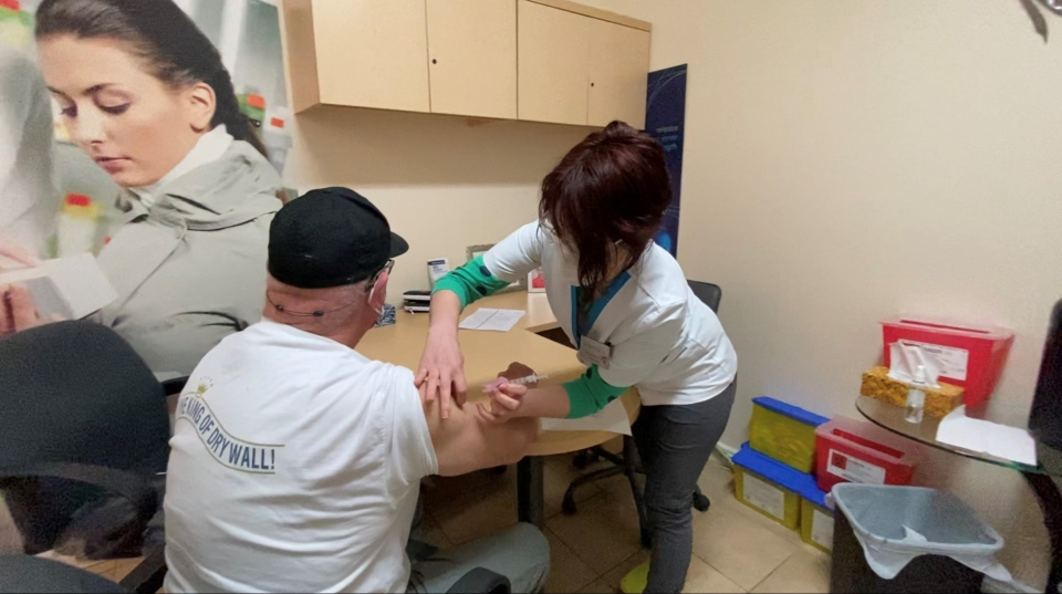 David King receives his first dose of the AstraZeneca vaccine from pharmacist Georgetta Botehkan at the Richmond Village Pharmacy. Ottawa, On. Apr. 19, 2020. (Tyler Fleming / CTV News Ottawa)