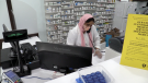Pharmacist Shamshad Mansuir books appointments for the AstraZeneca vaccine after the province lowered the age eligibility (Mike Arsalides/CTV News)