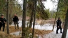"In this photo provided by the Gallatin County Sheriff's Office, officers from the sheriff's office and West Yellowstone Police Department are seen near the scene of a grizzly bear mauling just outside Yellowstone National Park near West Yellowstone, Mont. on April, 15, 2021. Authorities said Charles ""Carl"" Mock died Saturday of injuries sustained in the attack. (Gallatin County Sheriff's Office via AP)"