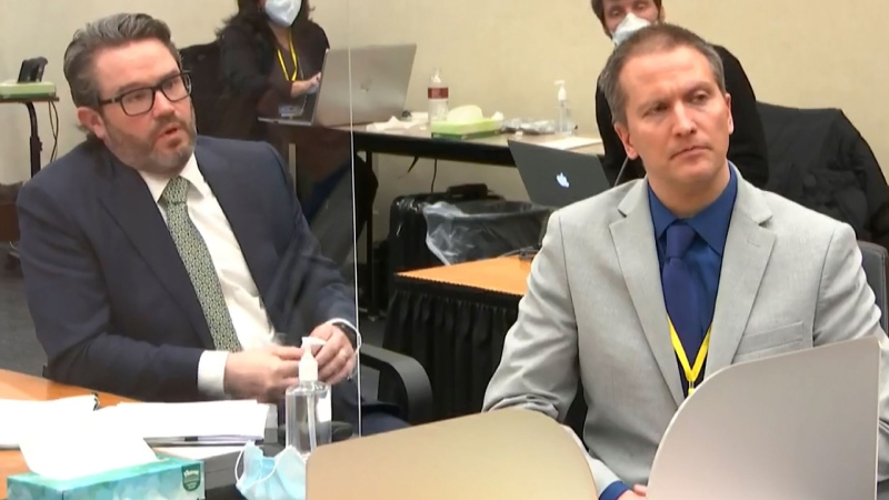In this image from video, defense attorney Eric Nelson, left, and defendant, former Minneapolis police officer Derek Chauvin, speak to Hennepin County Judge Peter Cahill after the judge has put the trial into the hands of the jury. (Court TV via AP, Pool)