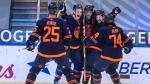 Edmonton Oilers' Darnell Nurse (25), Jesse Puljujarvi (13), Connor McDavid (97), Josh Archibald (15), Ethan Bear (74) celebrate a goal during third period NHL action against the Montreal Canadiens, in Edmonton, Monday, April 19, 2021 (The Canadian Press/Jason Franson).