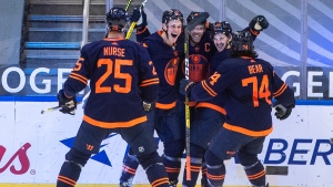 Edmonton Oilers' Darnell Nurse (25), Jesse Puljujarvi (13), Connor McDavid (97), Josh Archibald (15), Ethan Bear (74) celebrate a goal during third period NHL action against the Montreal Canadiens, in Edmonton, Monday, April 19, 2021 (The Canadian Press/Jason Franson).