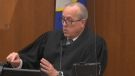 In this image from video, Hennepin County Judge Peter Cahill dresses the court after the judge put the trial into the hands of the jury on Monday, April 19, 2021, in the trial of Chauvin, in the May 25, 2020, death of George Floyd at the Hennepin County Courthouse in Minneapolis, Minn. (Court TV via AP, Pool)
