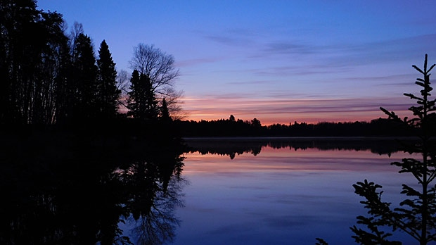 Sunrise on Wabigoon Lake. Photo by Gord & Connie Gould.