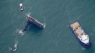 Rescue boats are seen next to the capsized lift boat Seacor Power seven miles off the coast of Louisiana in the Gulf of Mexico Sunday, April 18, 2021. (AP Photo/Gerald Herbert)