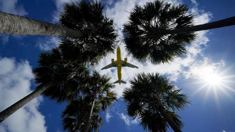 An airliner lands at Tampa International Airport in Tampa, Fla., on  March 19, 2021. (Gene J. Puskar / AP)