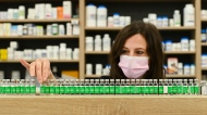 Pharmacist Barbara Violo arranges all the empty vials of the Oxford-AstraZeneca COVID-19 vaccines that she has provided to customers at the Junction Chemist which is a independent pharmacy during the COVID-19 pandemic in Toronto, on Monday, April 19, 2021. THE CANADIAN PRESS/Nathan Denette