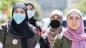 People protest against Law 21 outside Quebec Premier Francois Legault's office in Montreal, Sunday, June 14, 2020, on the one year anniversary of the controversial bill. The COVID-19 pandemic continues in Canada and around the world. THE CANADIAN PRESS/Graham Hughes