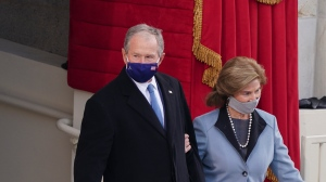 Former President George W. Bush, left, and former first lady Laura Bush wear protective face masks as they arrive for the 59th Presidential Inauguration at the U.S. Capitol in Washington in this Jan. 20, 2021 file photo. (Kevin Dietsch/Pool Photo via AP)