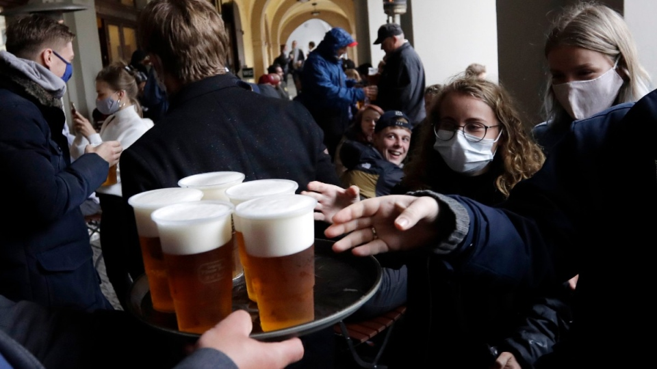 People line up for a beer at a restaurant terrace in Prague, Czech Republic, on May 11, 2020. (Petr David Josek / AP)