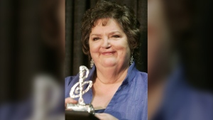 Rita MacNeil holds her ECMA lifetime achievement award on Feb. 20, 2005 in Sydney, N.S. MacNeil, a singer-songwriter from small-town Canada whose powerful voice explored genres from country, to folk, to gospel, died Tuesday night following complications from surgery. She was 68. THE CANADIAN PRESS/Jacques Boissinot
