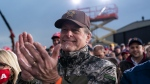 In this file photo from Oct. 17, 2020,, singer songwriter Ted Nugent applauds as President Donald Trump speaks during a campaign rally at Muskegon County Airport in Norton Shores, Mich. (AP Photo/Alex Brandon)