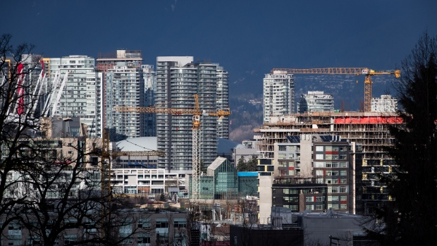 Construction cranes tower above condos under construction near southeast False Creek in Vancouver, on Sunday February 9, 2020. Metro Vancouver home sales hit 3,047 in August at a benchmark price of $1.0387 million, as the housing market continued its recovery from the COVID-19 pandemic. THE CANADIAN PRESS/Darryl Dyck