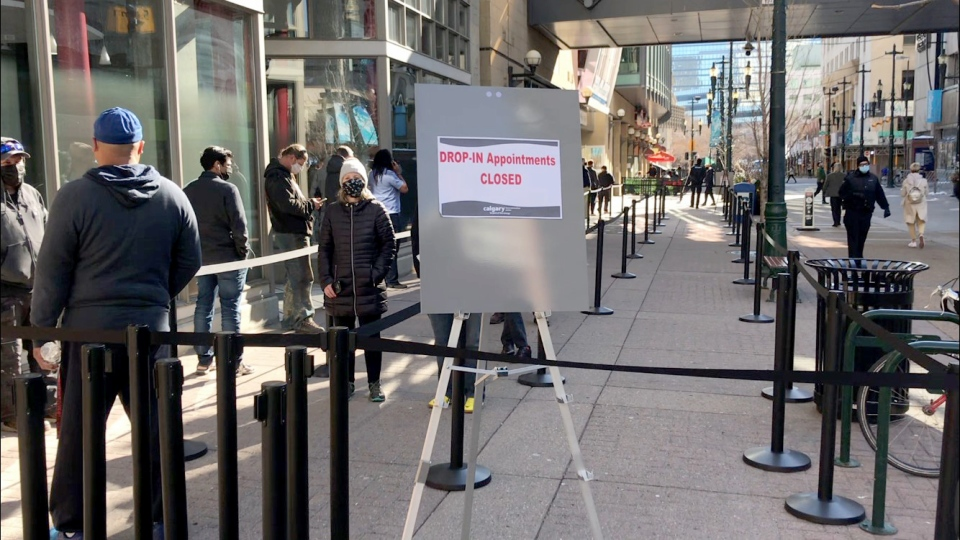 A walk-in clinic set up at the Telus Convention Centre for Albertans born in 1981 and earlier reached its daily capacity limit hours after opening on Tuesday.