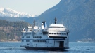 A BC Ferries vessel is seen arriving at Horseshoe Bay near West Vancouver on March 16, 2020. (Jonathan Hayward / THE CANADIAN PRESS)