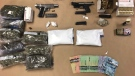 According to police, officers seized guns, ammunition, cannabis, cocaine, codeine and about $3,880 in cash from a Saskatoon home. (Saskatoon Police Service)