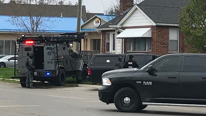 Police vehicles surround a home on Springbank Drive, east of Wonderland Road, in London, Ont. on Tuesday, April 20, 2021. (Sean Irvine / CTV News)
