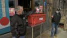 Brockville Mayor Jason Baker pulls the winning ticket for the $1000 prize in the Curbside Charity Challenge. (Nate Vandermeer / CTV News Ottawa)