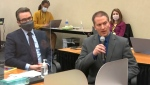 In this April 15, 2021, file image from video, defense attorney Eric Nelson, left, and former Minneapolis police Officer Derek Chauvin address Judge Peter Cahill at the courthouse in Minneapolis during Chauvin's trial in the death of George Floyd. (Court TV via AP, Pool, File)