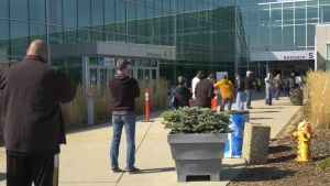 People line up for the AstraZeneca COVID-19 vaccine at the EXPO Centre in Edmonton on April 20, 2021.