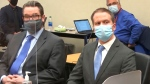 In this image from video, defense attorney Eric Nelson, left, and defendant, former Minneapolis police Officer Derek Chauvin, arrive for the verdict in Chauvin's trial for the 2020 death of George Floyd, Tuesday, April 20, 2021, at the Hennepin County Courthouse in Minneapolis, Minn. (Court TV via AP, Pool)