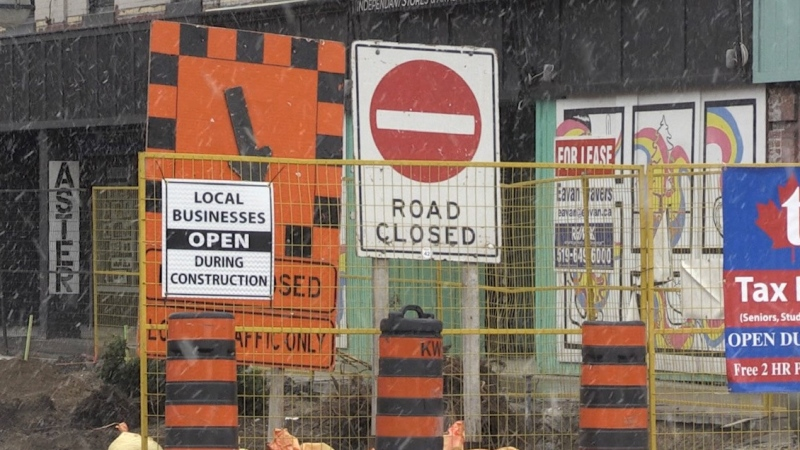 Construction signs on Dundas Street in London, Ont. are seen on Tuesday, April 20, 2021. (Jordyn Read / CTV News)
