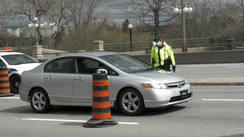 Ottawa police staff checkpoints, wave cars throug